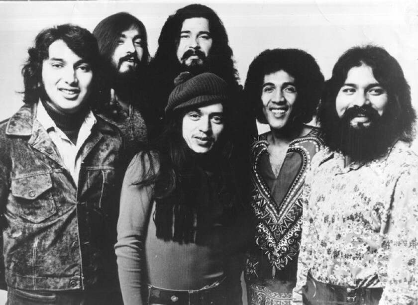 """Bobby Espinosa, second from left, played keyboard for El Chicano. The East L.A. band had top-40 hits in the 1970s with """"Viva Tirado"""" and """"Tell Her She's Lovely."""" """"El Chicano hit a groove that defined 'Latin soul' on the West Coast,"""" said guitarist and producer Ry Cooder. ,"""