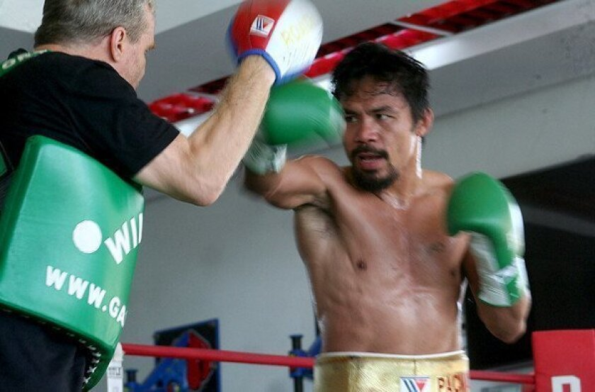 Manny Pacquiao's dilemma: preparing for fight in ravaged Philippines