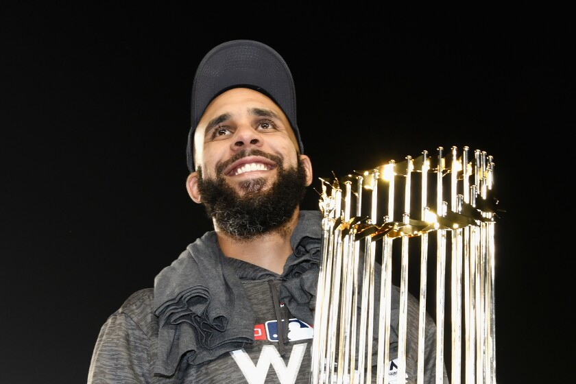 David Price #24 of the Boston Red Sox celebrates with the World Series trophy after his team's 5-1 win over the Los Angeles Dodgers in Game Five to win the 2018 World Series at Dodger Stadium on October 28, 2018 in Los Angeles, California.
