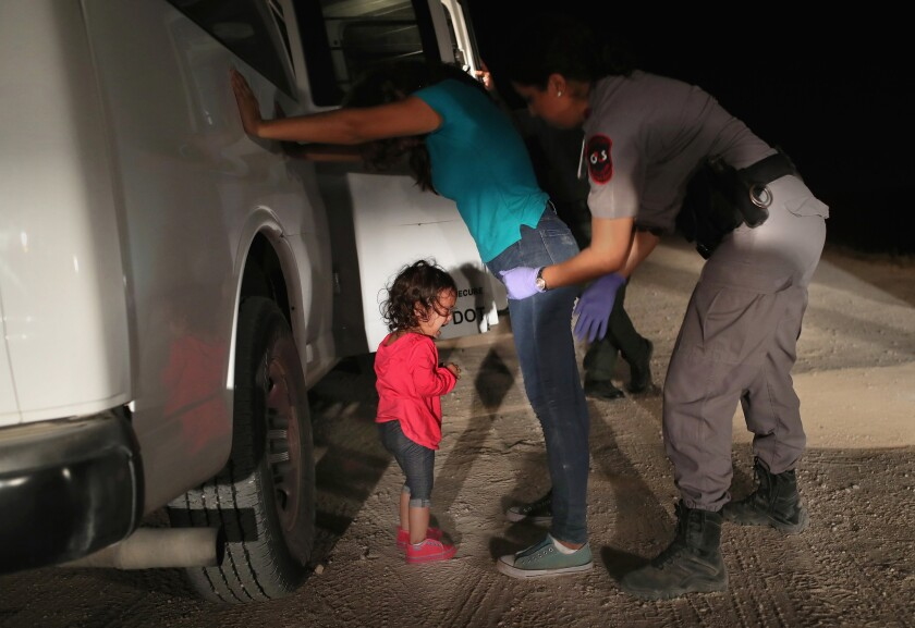 One of the images repeatedly seen in media coverage of family separations: A two-year-old Honduran girl cries as her asylum-seeking mother is searched and detained near the U.S.-Mexico border on June 12, 2018 in McAllen, Texas.