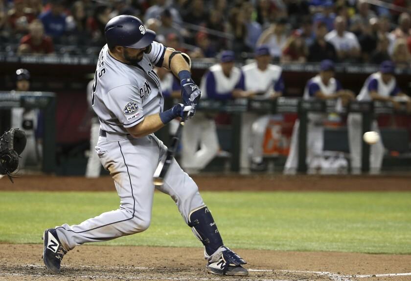 Austin Hedges hits a three-run home run against the Arizona Diamondbacks on Thursday.