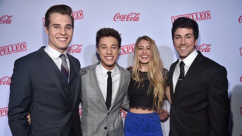 """From left, actors Marcus Johns, Cameron Dallas, Lia Marie Johnson and director Alex Goyette attend the premiere of Awesomeness TV's """"EXPELLED"""" in Los Angeles."""