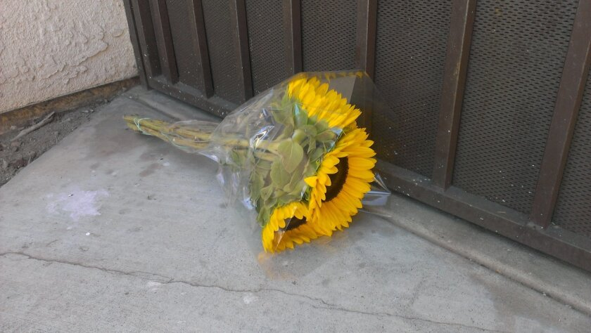 Sunflowers left at the door of the Haskell family home in San Marcos.