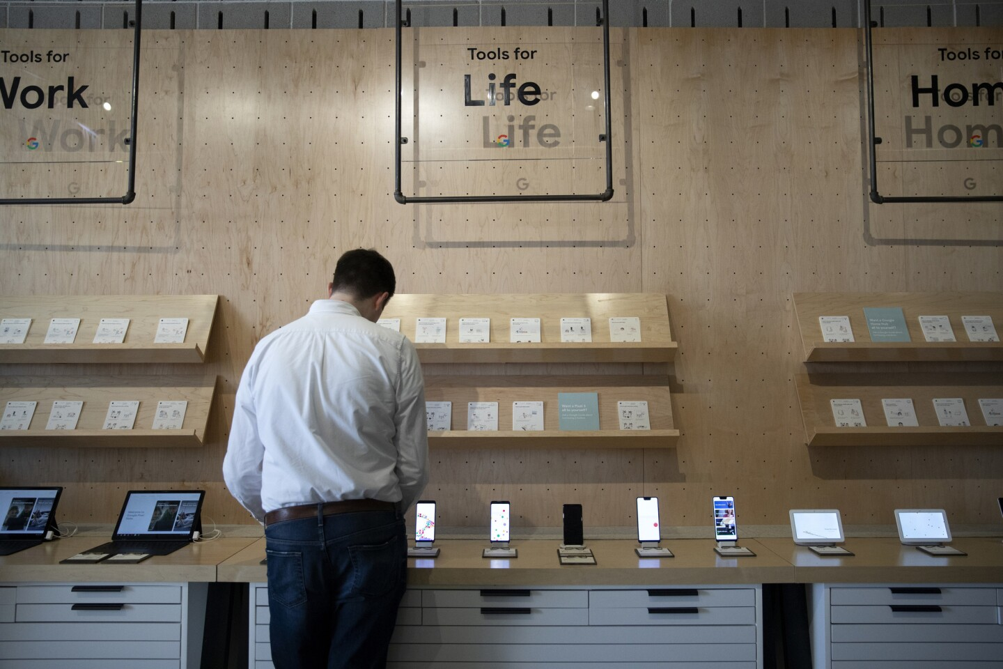 Customers explore the new pop-up Google Hardware Store on Oct. 18, 2018, in the Bucktown neighborhood of Chicago.