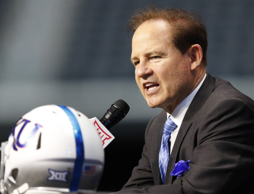 Kansas head coach Les Miles speaks on the first day of Big 12 Conference football media days on, July 15 in Arlington, Texas.