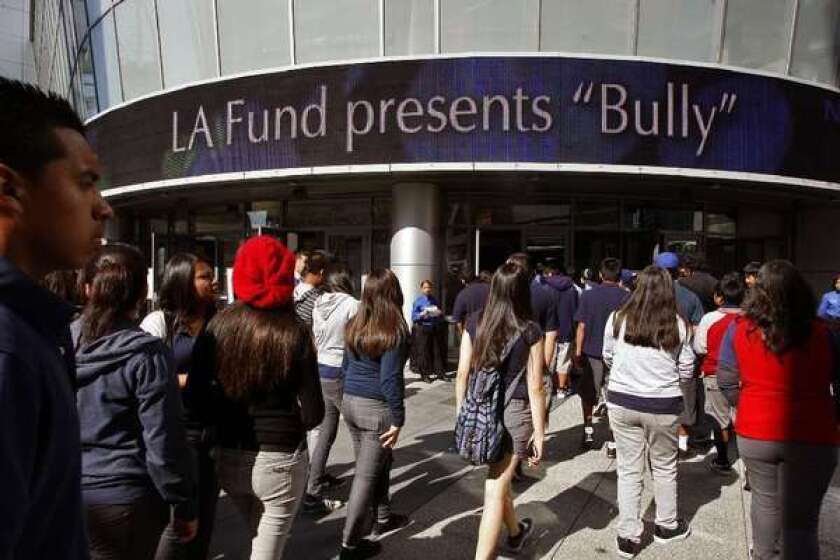 "Students attend a special screening in 2012 of the movie ""Bully."" Researchers who followed children from their middle-school years into early adulthood found bullying victims were far more likely to wind up with social, financial and emotional troubles."