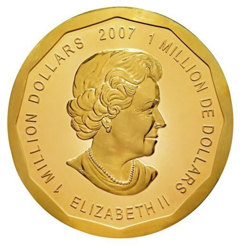 This undated photo released by the Dorotheum auction house in Vienna, Austria, shows the world's largest gold coin, which was auctioned Friday June 25, 2010, for euro 3.27 million (US dollar 4 million). The 2007 one million dollars Canadian Maple Leaf coin featuring an image of Britain's Queen Elizabeth II, weighs 100 kilograms (220 pounds) and has a diameter of 53 centimeters (21 inches). It was won by Spanish precious metal trading company Oro Direct. (AP Photo/Dorotheum Vienna) EDITORIAL USE ONLY; NO SALES; NO ARCHIVES