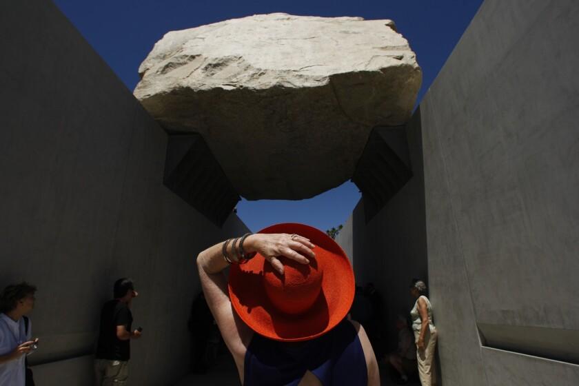 "Alisa Katz gazes at artist Michael Heizer's ""Levitated Mass"" at LACMA"