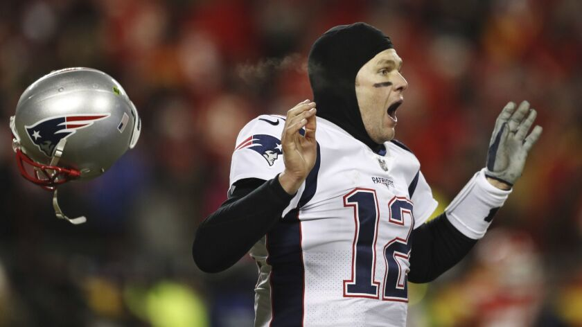 New England Patriots quarterback Tom Brady celebrates after defeating the Kansas City Chiefs in the