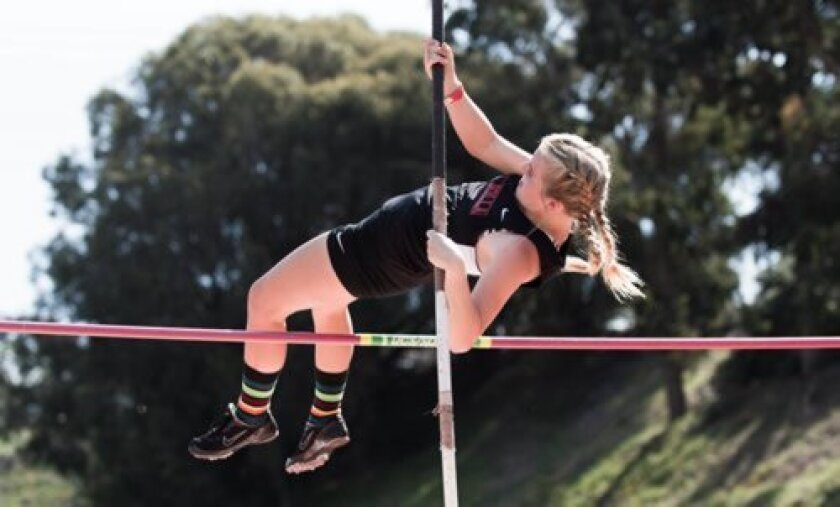 La Jolla sophomore Alyssa Burnley successfully vaults a height early in the pole vault competition at the Mt. Carmel Invitational March 29. Ed Piper
