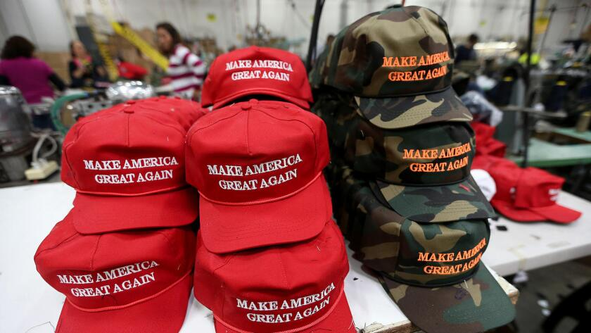 """Red and camouflage caps with President Trump's 2016 election campaign slogan """"Make America Great Again."""""""