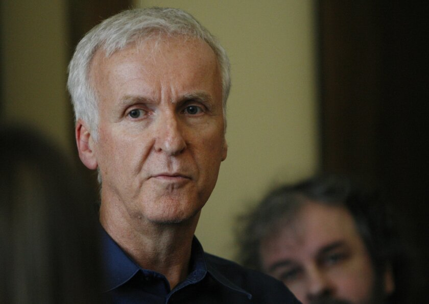 Movie director James Cameron talks to reporters at an event to promote the New Zealand film industry on Wednesday, Jan. 14, 2015, in Wellington, New Zealand. Cameron said the first Avatar sequel has been delayed until late 2017. (AP Photo/Nick Perry)