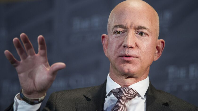 FILE - In this Sept. 13, 2018, file photo, Jeff Bezos, Amazon founder and CEO, speaks at The Economi