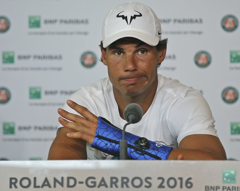 Nine-time champion Rafael Nadal announces he is pulling out of the French Open because of an injury to his left wrist during a press conference at the Roland Garros stadium in Paris, France, Friday May 27, 2016. The left-handed Nadal made the announcement at a hastily arranged news conference Frida