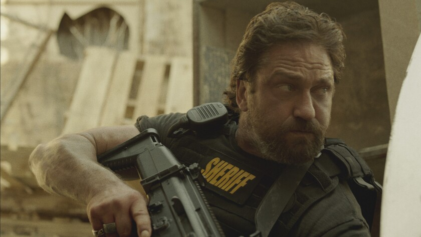 "Gerard Butler in the movie ""Den of Thieves."""