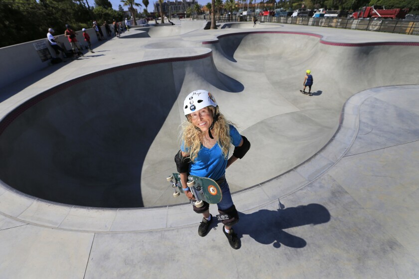 Skateboarder and author Barbara Odanaka takes a break from skateboarding at Vans Off the Wall Skatepark in Huntington Beach.