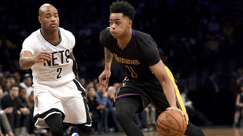 Lakers point guard D'Angelo Russell drives past Nets guard Jarrett Jack in the first half of a game Nov. 6 in Brooklyn.