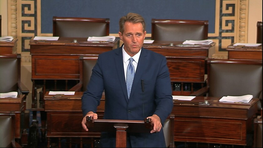 Sen. Jeff Flake (R-Ariz.), in an image from Senate television, announces on the Senate floor Tuesday that he will not seek reelection in 2018.