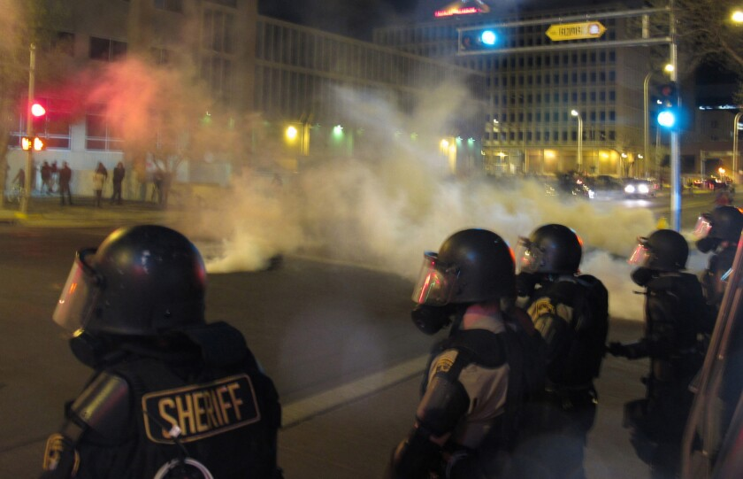 Riot police deal with a protest in downtown Albuquerque on March 30.