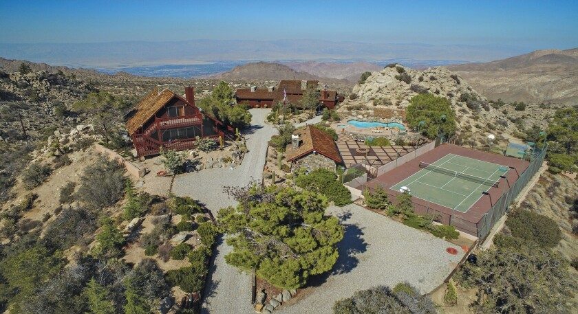 The desert hideaway includes a main house, guesthouse, pool house, tennis court, swimming pool and helipad.