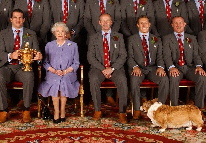 Queen Elizabeth, seen here in 2015 with her former corgi, Berry, and members of the England rugby team. The Queen's final corgi, Whisper, died recently.