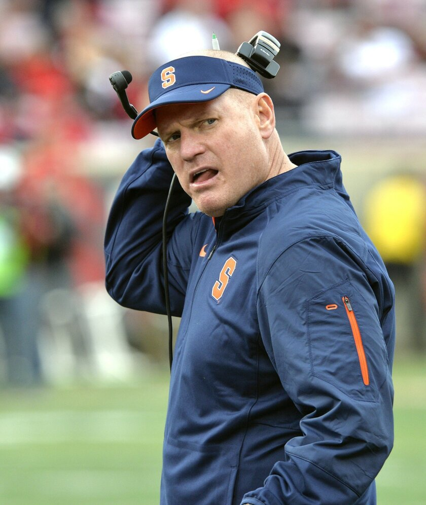 FILE - In this Nov. 7, 2015, file photo, Syracuse head coach Scott Shafer looks back at his bench following a penalty call against his team during the second half of an NCAA college football game against Louisville, in Louisville, Ky.Syracuse has fired football coach Scott Shafer two days after the team's eighth straight loss. Athletic director Mark Coyle announced the dismissal Monday, Nov. 23, 2015, and said a national search will begin immediately. Shafer will coach the season finale against Boston College on Saturday. (AP Photo/Timothy D. Easley, File)