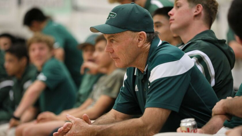 Longtime Poway wrestling coach Wayne Branstetter watches one of the matches during his last dual meet before retirement against visiting Del Norte High. His team won every match.