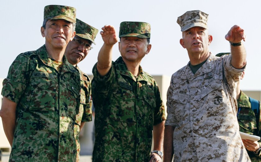 Marine Lt. Gen. David Berger (right) with Japan Ground Self-Defense Force officers.