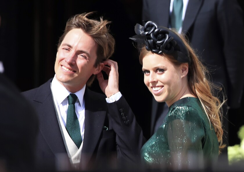 Britain's Princess Beatrice with her fiance, Edoardo Mapelli Mozzi, in August 2019.