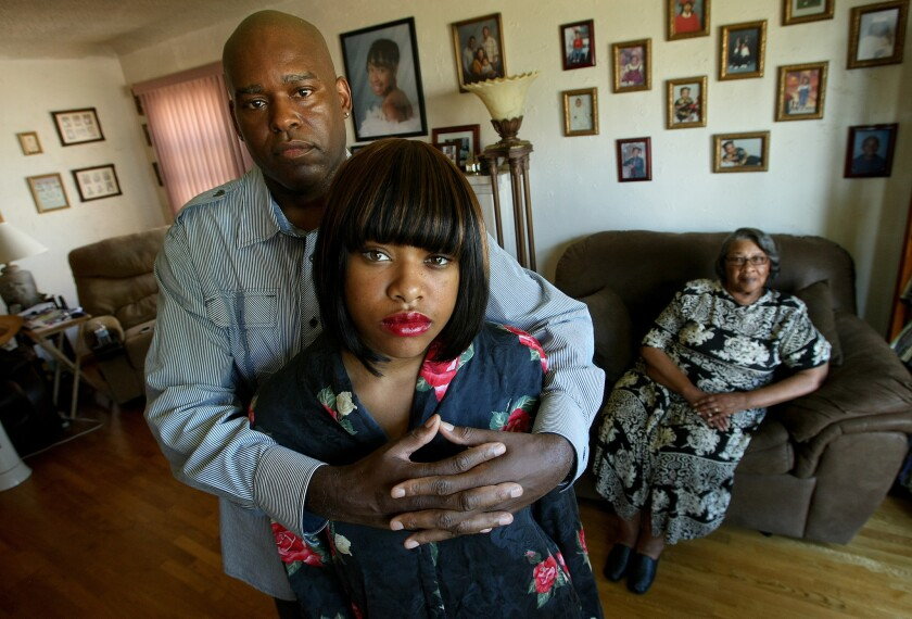 Stephanie Hooks waited for 10 minutes and 30 seconds for LAFD paramedics to arrive at her Gramercy Park home in 2009 after she suffered cardiac arrest. She later died. Her husband, Alvin Hooks, left, their daughter, Alnisha, 20, and mother- in-law Catherine Green, 72, are suing the city.