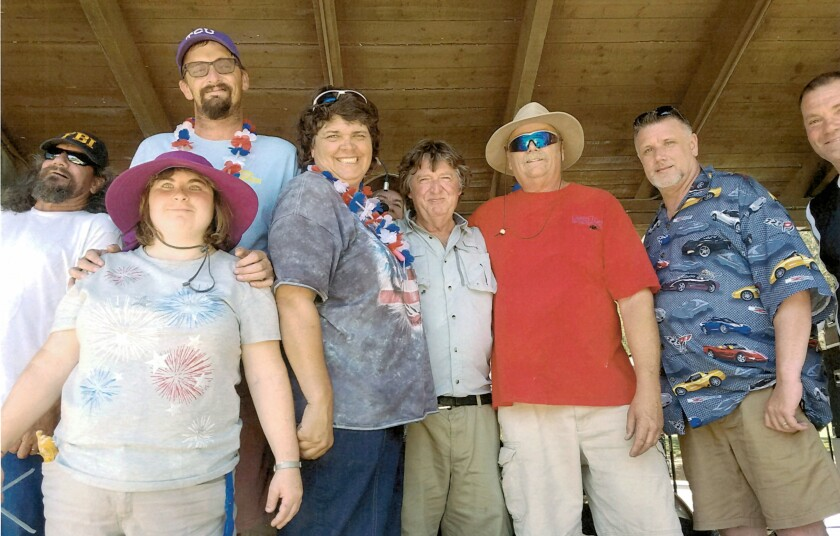 Black Canyon Blues Band members and friends enjoying a July 4 event last year are, from left, lead guitarist Max Mittman, Emma Quinn, Tim Montague, Debbie Gilespy, guitarist and songwriter Robert Anderson, drums player Dave Finley, keyboardist Rob Ward and bass player Michael Moore.