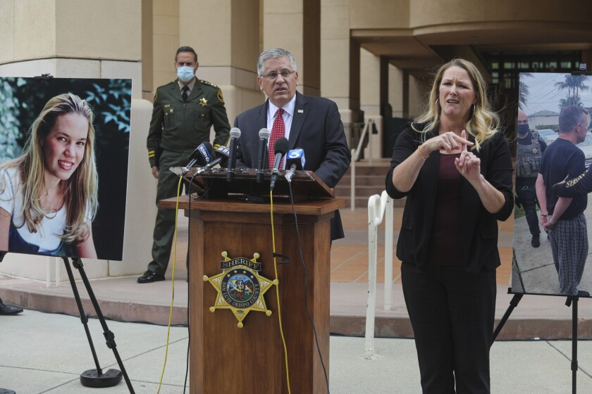 Cal Poly President Jeffrey Armstrong, center, speaks during a news conference in San Luis Obispo, Calif.