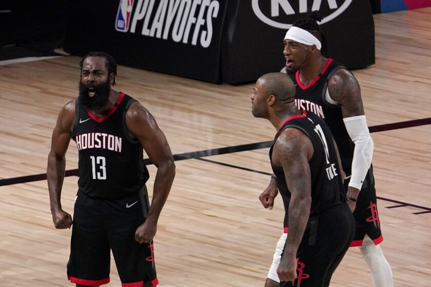 Houston Rockets' James Harden, P.J. Tucker and Robert Covington celebrate.