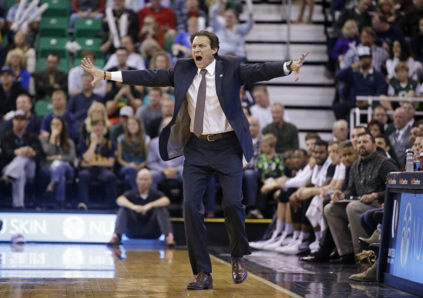 FILE - In this Nov. 7, 2015, file photo, Utah Jazz coach Quin Snyder shouts to his team during the team's NBA basketball game against the Memphis Grizzlies in Salt Lake City. The Jazz are in position to make the playoffs for the first time since 2011-12 and finish above .500 for the first time sinc
