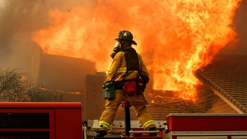October 22, 2007, San Diego, California, USA_ A San Diego firefighter from station 3, fights a fire