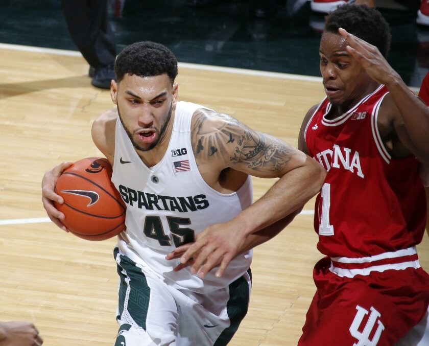 Michigan State's Denzel Valentine, left, drives against Indiana's Kevin Yogi Ferrell during the first half of an NCAA college basketball game, Sunday, Feb. 14, 2016, in East Lansing, Mich. Michigan State won 88-69. (AP Photo/Al Goldis)