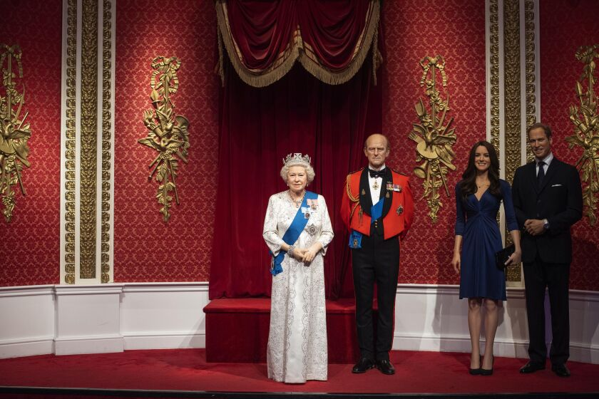 The empty space left after the figures of Britain's Prince Harry and Meghan, Duchess of Sussex, were removed Thursday at Madame Tusssauds London.