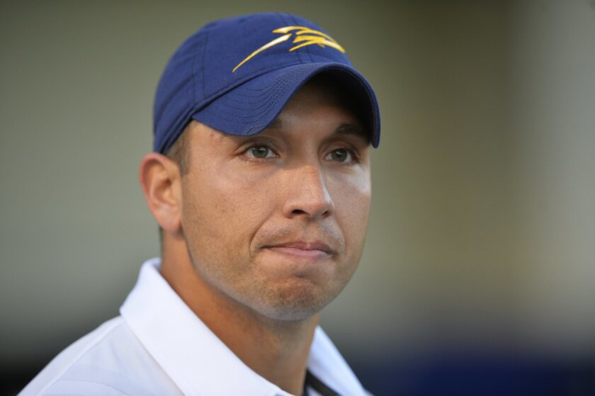 FILE - In this Oct. 10, 2015, file photo, Toledo head coach Matt Campbell reacts after a 38-7 win over Kent State in an NCAA college football game in Toledo, Ohio. The 35-year-old Ohioan isn't climbing the career ladder as much as he is bounding up the stairs to success. (AP Photo/David Richard, Fi