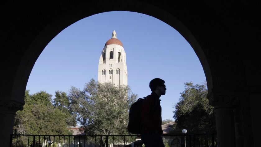FILE - In this Wednesday, Feb. 15, 2012 file photo, a Stanford University student walks in front of