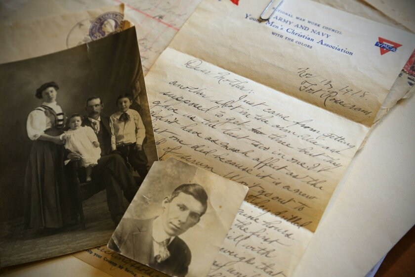 Letters from Vere Rhodimer whose portrait is bottom right. In family photo, from left: mother Elma, sister Dorothy, father Lewis Beemer and Vere Rhodimer.