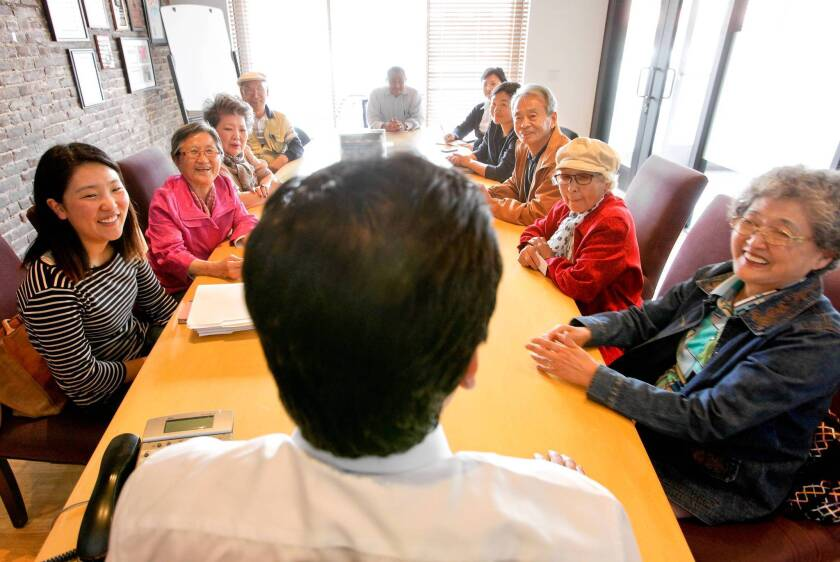 Korean senior citizens meet with state Sen. Kevin de Leon, foreground, at his headquarters in Los Angeles to express their opinions about affordable housing. Often isolated by linguistic and cultural barriers, their voices were rarely heard in the public debate, but the Korean Resource Center aims to change that by coaching them in civic activism and bridging the language gap. Kate Kang, far left, of the resource center, was there to interpret during the meeting.