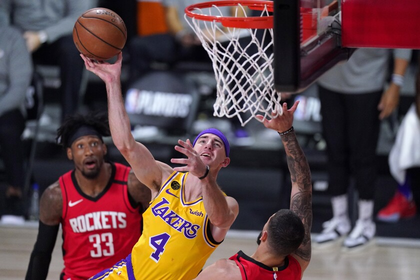 Lakers guard Alex Caruso puts up a shot in front of Houston's Austin Rivers and Robert Covington.
