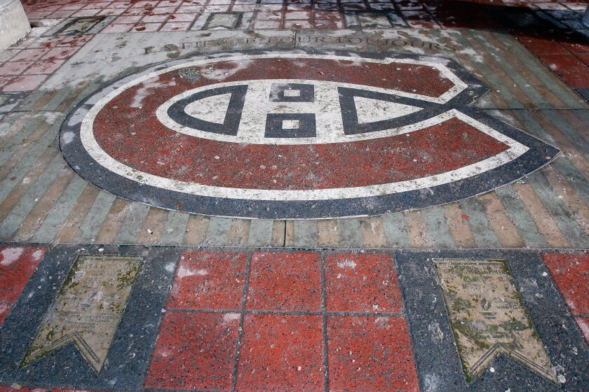 A sidewalk tribute to the Montreal Canadiens and their Stanley Cup wins located near the site of the old Montreal Forum in 2009.