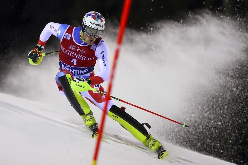 Switzerland's Daniel Yule competes during an alpine ski, men's World Cup slalom in Madonna di Campiglio, Italy, Wednesday, Jan. 8, 2020.(AP Photo/Alessandro Trovati)