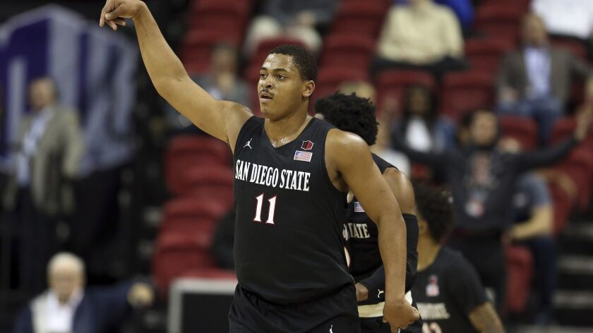 San Diego State's Matt Mitchell reacts after sinking a 3-point shot during the first half of the team's NCAA college basketball game against Nevada in the Mountain West men's tournament Friday night in Las Vegas.