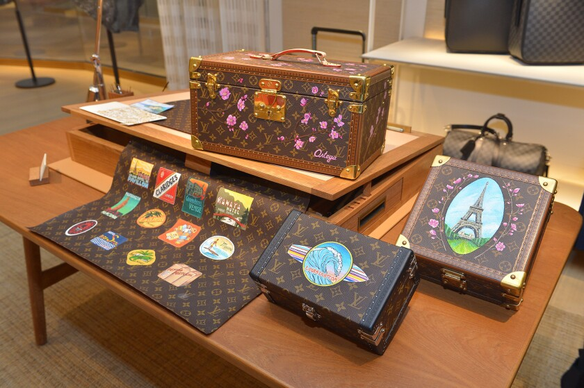 The recently renovated Louis Vuitton store at South Coast Plaza in Costa Mesa has a full-time artist on hand for personalizing services such as hand-painting, hot stamping and engraving.