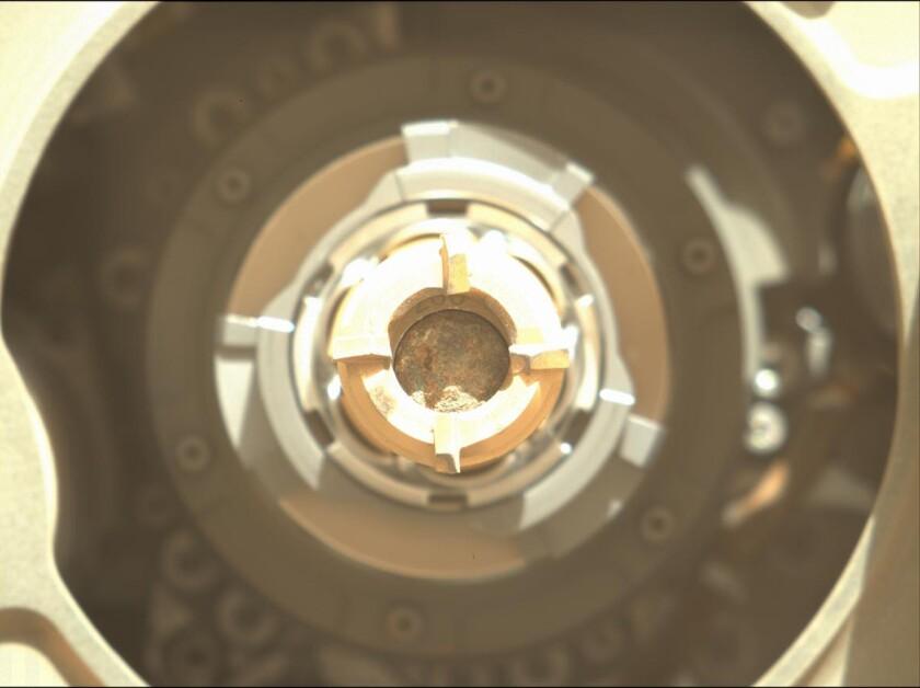 Rock is seen inside rover equipment.