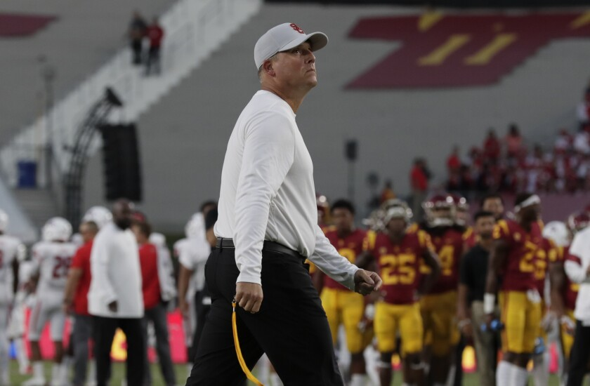USC football coach Clay Helton is shown during warmups for the Fresno State game at the Coliseum on Aug. 31.