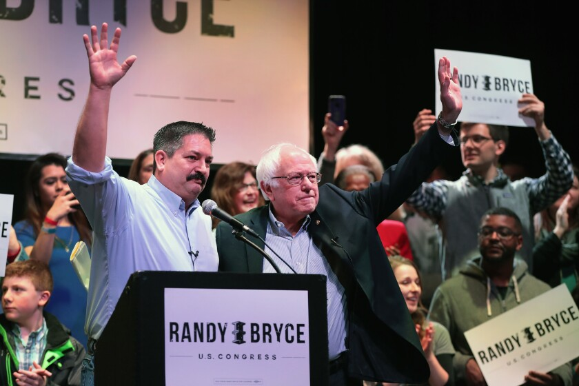 Sen. Bernie Sanders campaigns with Randy Bryce at a rally on Feb. 24, 2018, in Racine, Wis. Bryce, a union ironworker, is hoping to defeat House Speaker Paul Ryan to represent Wisconsin's 1st district.