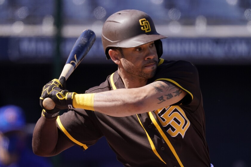 Padres left fielder Tommy Pham bats during a spring training baseball game against the Chicago Cubs